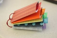 This would be a fun invite for a party, with a different detail in each roll. Toilet paper tube book with tabs.