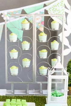 What a fun way to display cupcakes at this Mint Birdie Baby Shower with Lots of Really Cute Ideas via Kara's Party Ideas | Cake, decor, cupcakes, games and more! KarasPartyIdeas.com #birdieparty #birdparty #birdpartyideas #partydecor #babyshower