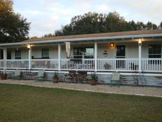 Manufactured home porch addition- notice the antique tin skirting. From mobilehomeliving.org  #porch