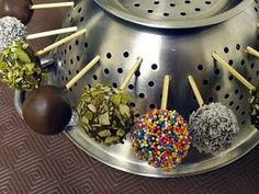 """Just noticed how popular Cake Pops are becoming.... yet I still laid (lay?) them down on the pan to dry....   Then I saw this.... Use the colander to dry them without getting that """"flat side"""" :)"""