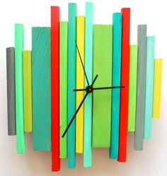 colorful wooden DIY clock..I like it but maybe just.. in natural and stained wood. Marquette Robertson!!