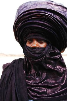 The Tuareg Tribe. The men wear the veils not the women. Called the Blue Men of the Desert because the indigo dye in their cloth rubs off on their skin giving it a blue tinge.