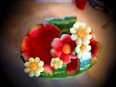 Watermelon Basket!  I made a watermelon basket once and think this one is quite cute... might try this style next.