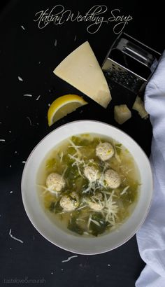 This Italian Wedding Soup, made with chicken, is light and healthy, but so delicious with buttery Parmesan and a bit of fresh lemon.   @tasteLUVnourish   #soup #weddingsoup #meatballs #chicken #parmesan #healthy #light