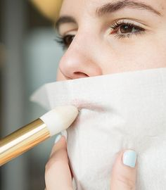 For long-lasting lip color, swipe on your shade, lay a tissue over your mouth, and then dust translucent powder over it to set the color.