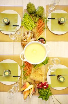 Fondue party table setting - with the food spread in the middle with fondue dipping shared by 4.