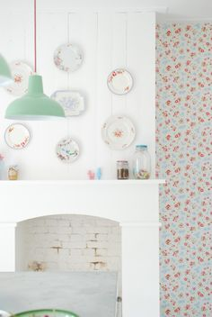 plates on the wall, and the light fixture
