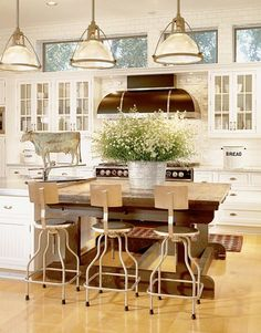 Kitchen- Table extending the island, transom windows above cabinets
