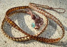 Triple Leather Wrap with Bronze Flower by mollymccarthy on Etsy, $65.00