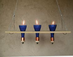 Cut Bottles Become a Candelabra, Drinking Glasses and More