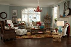 How to get this eclectic beach cottage look. Red, turquoise accents.