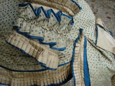 1870s extant French bodice off ebay. Detail of cuff- ruffles and tiny pleats, and piping too.