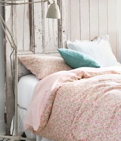I like the colour scheme here. Very sweet. Nice for a girl's room