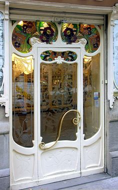 Amazing art nouveau door in Barcelona.  Love the stained glass panels