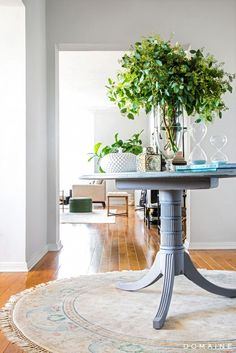 Exclusive: Tour Margo & Me's Hollywood Haven | DomaineHome.com // Flea market treasures atop a round entry table.