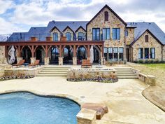 Rustic French-country style mansion ranch home in Montserrat outside Fort Worth, Texas.