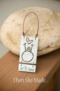 Snowman Ornament Tutorial, SEP 13, 2013. To make this ornament you will need the following: 1 block of Sculpey or Premo clay, Pearl color, Snowman stamp, Long Razor, Paper piercer or toothpick, Brown paint, Lumiere acrylic, Wire, Wire cutters, Needle nose pliers, Polyurethane.