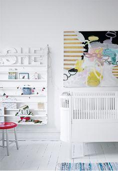 White nursery with art.