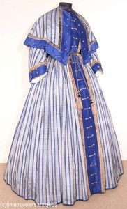 Civil War era dress and cape with Union military influence.