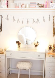 my makeup vanity is definitely one of my favorite spaces, and it doesn't even begin to look as gorgeous as this one here!