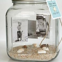 Beach memories in a mason jar. A cute DIY way to save that beach vacation. A little sand, a few shells you collected and photos. Wrap some twine or rope around the lid and tag it with the location and date. Seaside Inspired loves this idea and can see an entire collection in a beach cottage (use different height jars for interest)