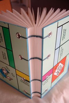 art manuai, game hand, books upcycled, book project, monopoly board craft, diy craft, hand made, handmade books, board games crafts