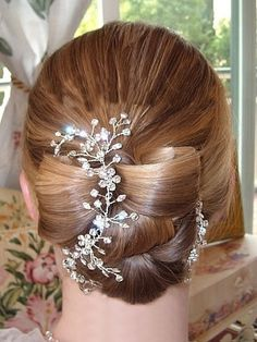 Sparkling rhinestone hair vine - lightweight and bendable, can be shaped to the curve of your hairstyle - by One World Designs Bridal Jewelry.