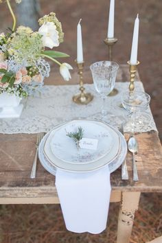 Vintage place setting with sprig name tag and gold taper candle holders. #vintagewedding #goldaccents #weddingchicks Design: River Kiss Weddings ---> http://www.weddingchicks.com/2014/04/28/wedding-ideas-with-some-va-va-voom/