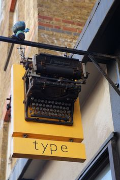 A sign in East London - what kind of shop is this? Do they sell/repair typewriters? Are they a secretarial agency? Are they a print shop/copy shop?...Hm  Just discovered this is a shop in Shoreditch selling quirky interior finds! (including typewriters!)