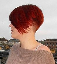 nicely tapered nape w this inverted red bob style More