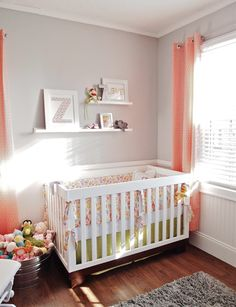 i love this nursery...could almost be used as a gender neutral nursery (maybe if more lime green and less coral were used).  love the grey walls (and the beadboard), they really make the colors pop (plus i love grey anyways).  all the details are so sweet.