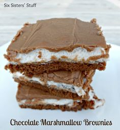 Mom's Famous Chocolate Marshmallow Brownies- seriously the best brownies you will ever have! They are addicting from sixsistersstuff.com #brownies #recipe #dessert