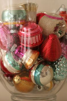 Beautiful, vintage ornaments in a large glass jar/vase.
