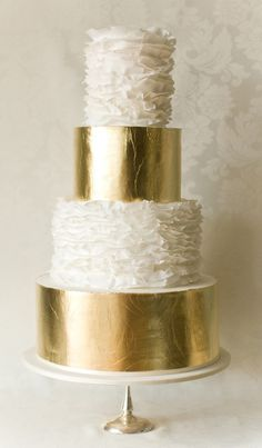 White ruffle and gold wedding cake