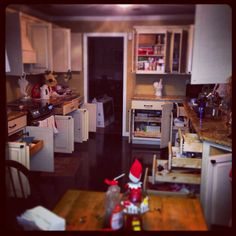 Our elf. He made breakfast and opened every cabinet and drawer. drawer decemb, cabinet