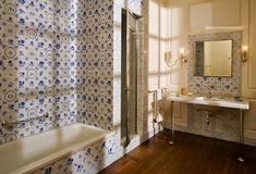 panel and tiled guest bath at Castle Hill by David Adler via New York Social Diary