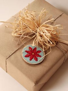 The lucky recipient of this tiny gift box gets a birch needlepoint disk, yarn, needle, pattern, even hanging twine. Only $25! #christmas #diy