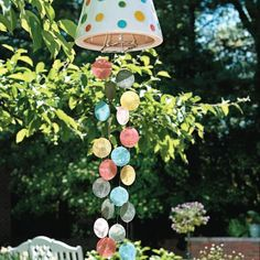 Create your own colorful wind chimes out of a flower pot and glass shells!