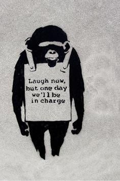 Laugh Now, Sandwich Board Wearing Monkey by Banksy