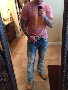 Cowboy boots and tattoos