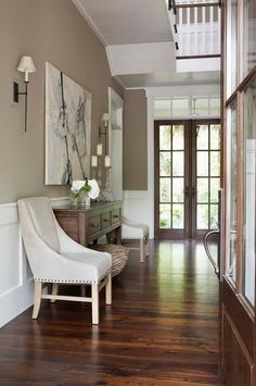 Berkshire Beige AC-2 / Flat by Benjamin Moore wall color.Trims are Sherwin Williams pure white. the floors are reclaimed heart pine floors with a dark custom ebony and dark walnut stain.
