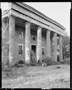 "Wade House, Huntsville vic., Madison County, Alabama. The brick columns  exposed brick front are highly unusual. Most homes of the time were covered with ""scored plaster"" to resemble marble, and columns were made of wood. In Alabama, most antebellum columns encase whole tree trunks!"