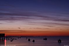 Can you spot the skinny crescent Moon just above the horizon? The other two celestial objects are Venus and Jupiter. Photo by Pete Lawrence on Sunday, August 24, 2014.