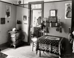 """Love this room especially the table cloth. Great to view in full size. Circa 1905. """"New York tenement."""" With a number of tiny inhabitants in evidence. Dry plate glass negative, Detroit Publishing Company."""