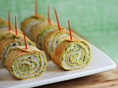 """Pesto Tortilla Pinwheels.8 ounces cream cheese, softened 1/2 cup pesto 2/3 cup shredded Parmesan cheese 3 large flour tortillas (12"""") 1 pound thinly sliced turkey or ham deli meat"""