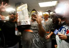 San Francisco Giants' Pablo Sandoval (48) celebrates with the World Series trophy the clubhouse following their 3-2 win in Game 7 of baseball's World Series against the Kansas City Royals at Kauffman Stadium in Kansas City, Mo., on Wednesday, Oct. 29, 2014.  (Nhat V. Meyer/Bay Area News Group)