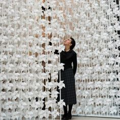 Wind Portal by Najla El Zein. Zein installed 5000 spinning paper windmills in a doorway at the V&A museum in London. Each windmill is attached to a small tube, through which air flows. A computer program controls where air is released, causing ripples of movement. #art