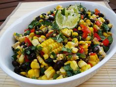 Roasted Corn & Black Bean Salad-    Roasted Corn & Black Bean Salad      2 cups (3 ears) roasted corn      1 (16 oz) can black beans, drained and rinsed      ¾ cup red pepper, small diced      2 Tbl. shallot, minced      2 Tbl. jalapeño pepper, minced      3 Tbl. cilantro, roughly chopped      2 Tbl. olive oil      2 – 3 Tbl. lime juice      pinch salt and pepper to taste        Roast corn according to my Oven Roasted Corn on the Cob post. Allow to cool and remove the kernels ...