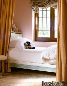 In designer Dana Abbott's comfortable and casual California home, a pale green antique French bed snuggles behind curtains in her youngest daughter's bedroom.