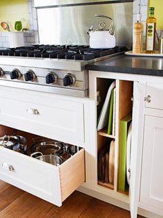 Two drawers with full-extension glides below the rangetop put cooking necessities like pots and pans within easy reach.